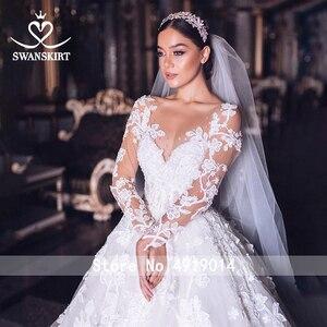 Image 2 - Vestido de boda de lujo 2020 Swanskirt con apliques de cuentas, Vestido de baile de talla grande, Vestido de novia de manga larga con flores, Vestido de novia QY01