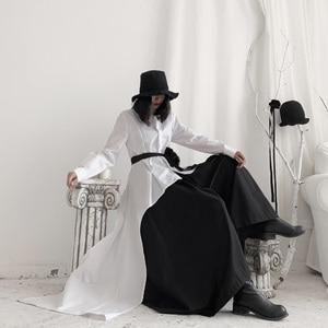 Image 3 - [Eam] 女性黒非対称リボンブラウス新ラペル長袖ルーズフィットシャツファッションタイド春秋2020 19A a544