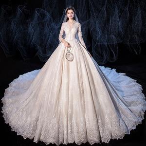 Image 1 - אגלי נצנצים אפליקציות תחרת V צוואר ארוך שרוול מדהים כדור שמלת חתונת שמלה עם 1.5m תמונה קפלת רכבת