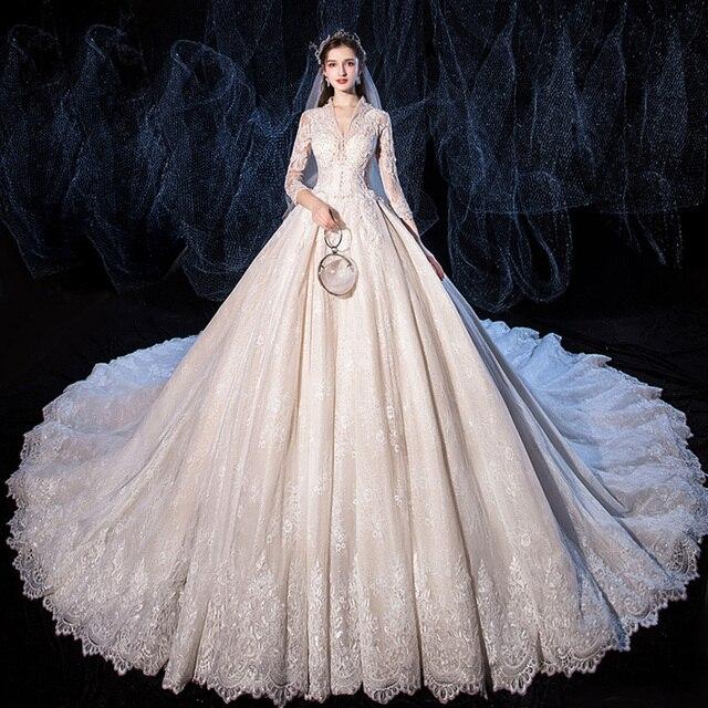 אגלי נצנצים אפליקציות תחרת V צוואר ארוך שרוול מדהים כדור שמלת חתונת שמלה עם 1.5m תמונה קפלת רכבת