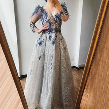 Бальное платье с длинным рукавом v образным вырезом и перьями