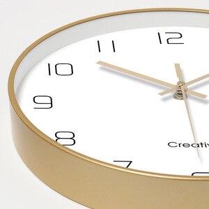 Image 2 - Einfache Kreative Kunst Gold Mode Wanduhr Moderne Home Studie Stumm Uhr Mode Dekorative Quarz Uhr