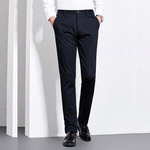 Image 3 - Мужские Теплые повседневные брюки, черные или темно синие Однотонные эластичные брюки в деловом стиле, новинка для зимы 2019