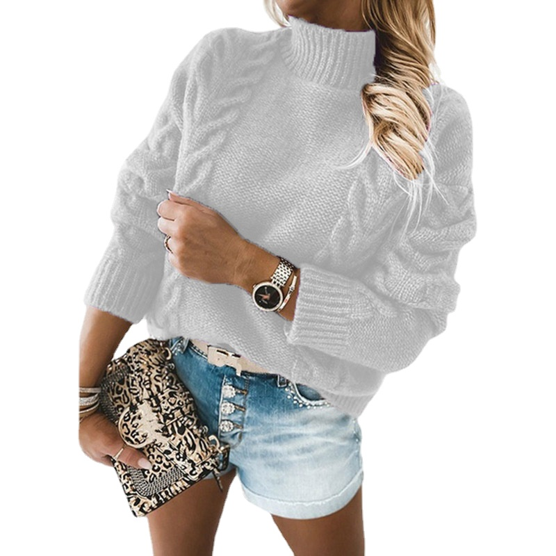 Pull tricoté à col roulé à manches longues et franges