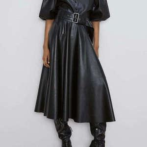 Image 1 - Новинка 2020, модные женские юбки из искусственной кожи на осень и зиму, женские юбки с высокой талией, трапециевидные миди до середины икры, длинные черные, винно красные, с поясом