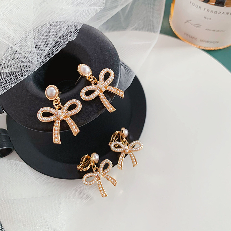 Korean <font><b>Elegant</b></font> Bowknot Simulated Pearl <font><b>Earrings</b></font> for Women Girls <font><b>Gold</b></font> Color Metal Hollow Out Big Statement <font><b>Drop</b></font> <font><b>Earrings</b></font> <font><b>Jewelry</b></font> image