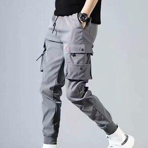 Новые модные мужские шаровары в стиле хип-хоп, облегающие штаны-карандаш для тренировок, мужские повседневные спортивные штаны-карго, Черны...
