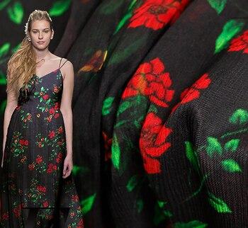 Feminine silk dress fabric with black bottom and red rose print swishing yarn
