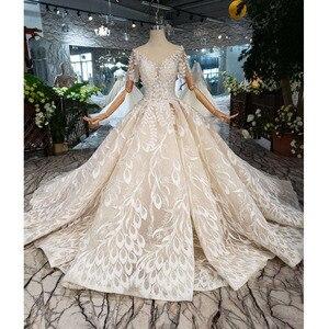 Image 1 - BGW HT4292 dantel düğün elbisesi yaprak şekli aplike o boyun tavuskuşu tarzı prenses gelin elbiseleri kız Vestidos De Novia 2020