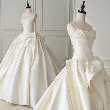 أفضل فرنسا الساتان الكرة ثوب الزفاف مع الطية Suknia Slubna بسيط زي العرائس حجم كبير Sukienki