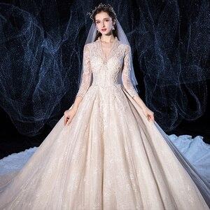 Image 4 - אגלי נצנצים אפליקציות תחרת V צוואר ארוך שרוול מדהים כדור שמלת חתונת שמלה עם 1.5m תמונה קפלת רכבת