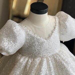 Image 2 - לבן נצנצים ילדה שמלת Baptismal שמלה לתינוק אלגנטי המפלגה בנות שמלות גדול bow טוטו נסיכת חתונה תינוקת שמלה