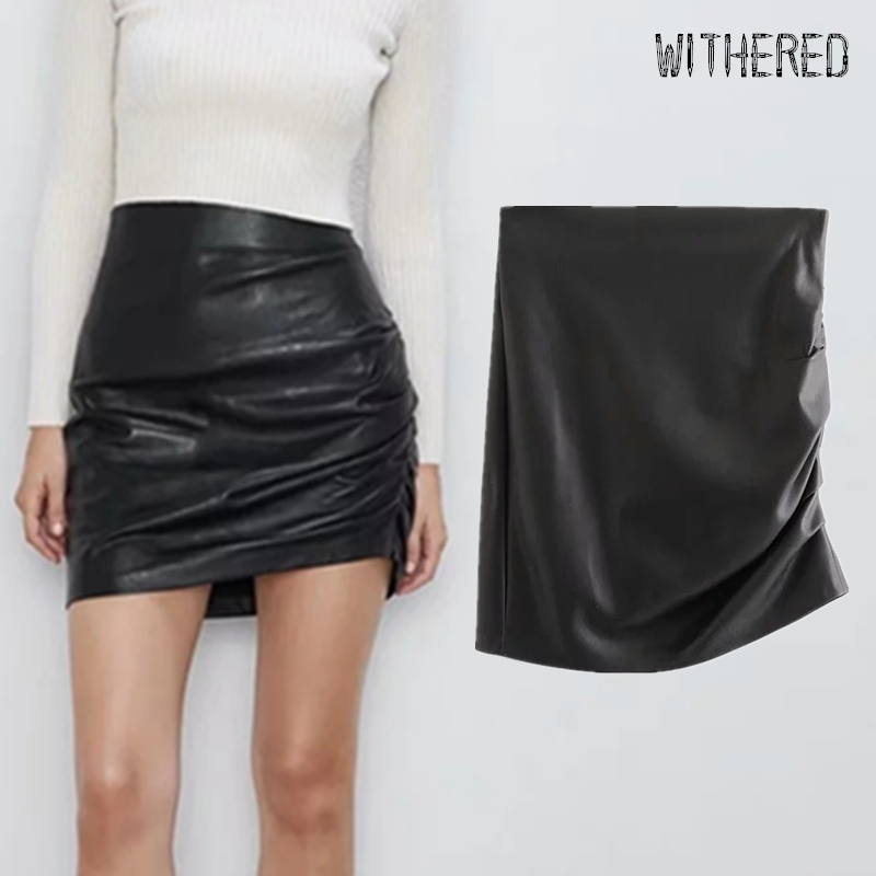 Withered PU Leather Skirt Women England Elegant Personality Bow Package Hips Sexy Faldas Mujer Moda 2019 PU Mini Skirts Womens