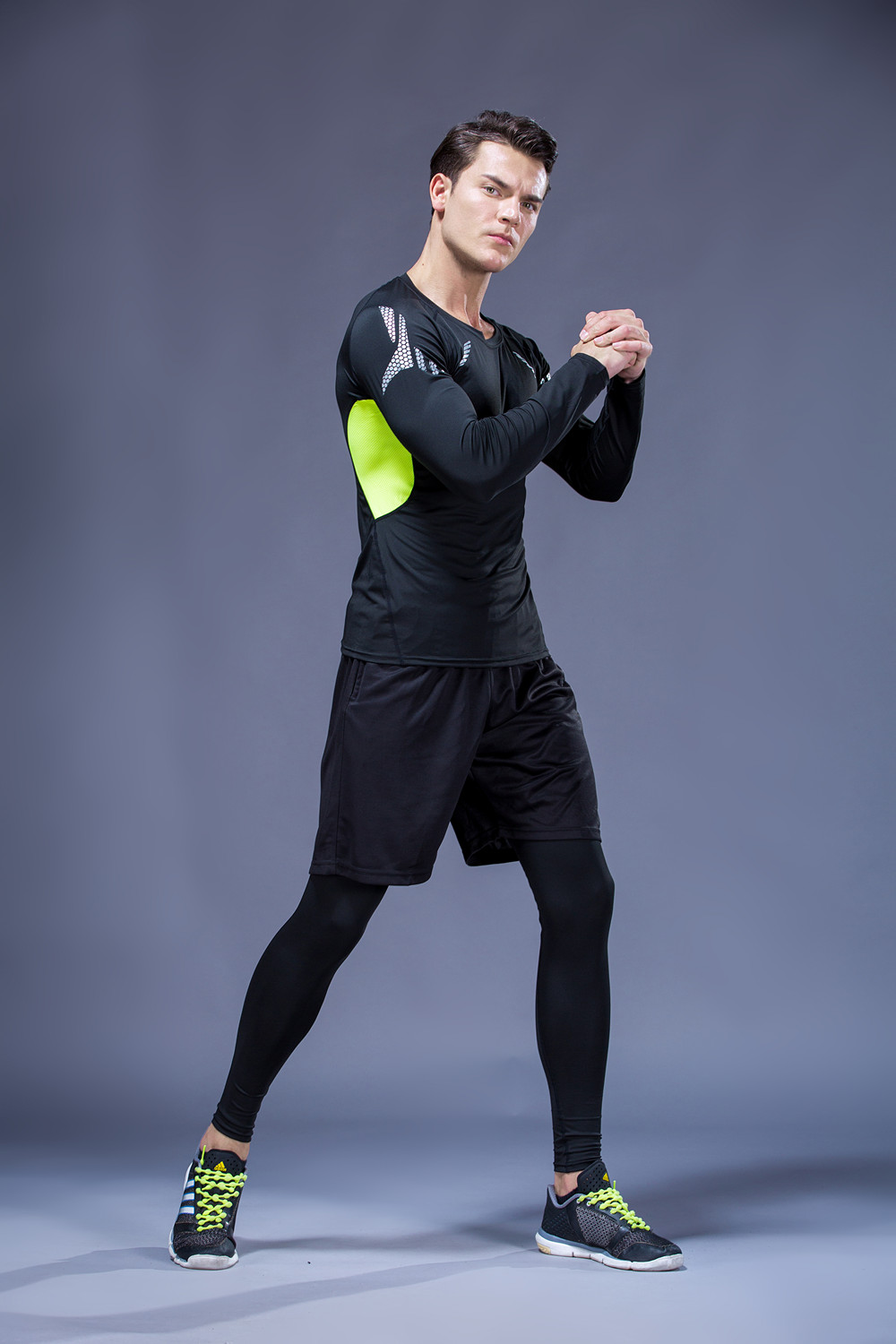 Foto on men from the left 5 pcs compressions clothes for gym. Men's 5 pcs compression tracksuit sports