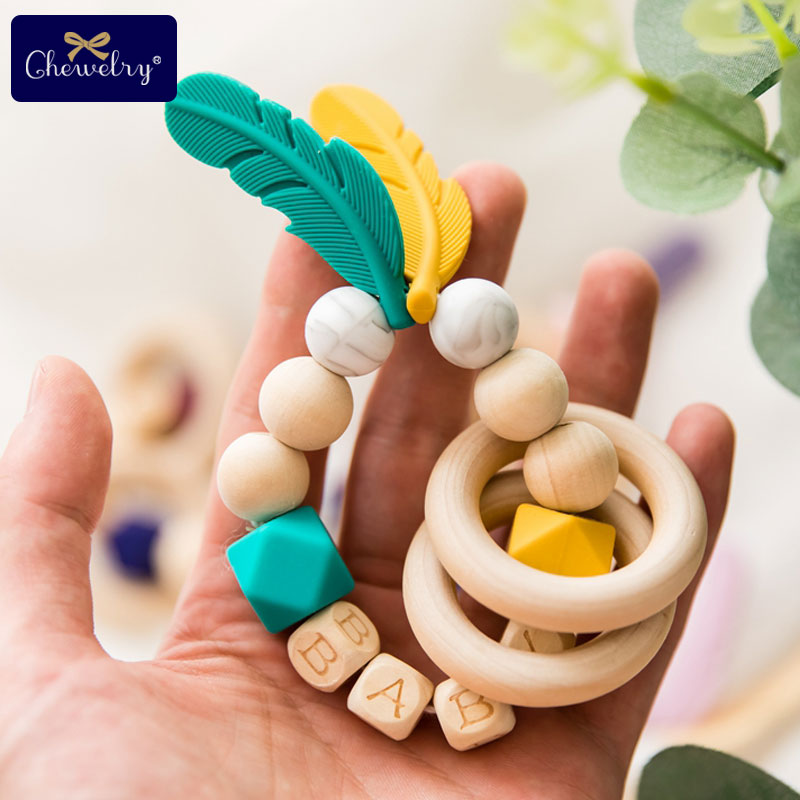 1pc Baby Toys Silicone Nursing Feather Bracelet Beech Wooden Teething Rings DIY Baby Customize Name Wood Rattles Teether Rodents in Baby Teethers from Mother Kids