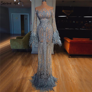 Image 1 - Azul manga longa penas lantejoulas vestidos de noite dubai sereia vestidos de noite luxo 2020 sereno hill la60932