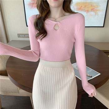 Autumn and winter new hollow knit sweater women's solid color design sense of slim and thin V-neck s