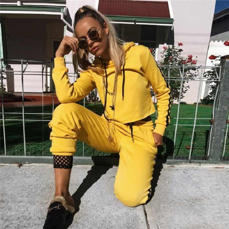 ZOGAA primavera 2019 moda Casaul chándal mujer 2 piezas conjunto Top y pantalones rayados Patchwork cremallera Sexy sudadera traje de sudor