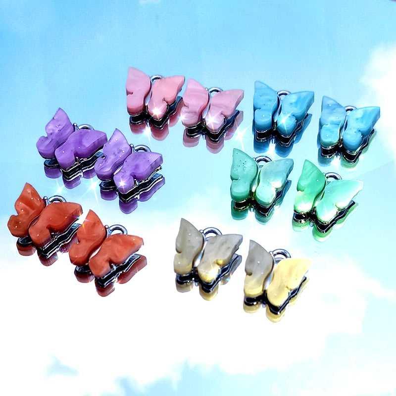 JJFOUCS 50 ชิ้น/เซ็ตแฟชั่น Shining อะคริลิคเรซิ่นผีเสื้อสีเงินสำหรับต่างหูสร้อยคอจี้ DIY เครื่องประดับ