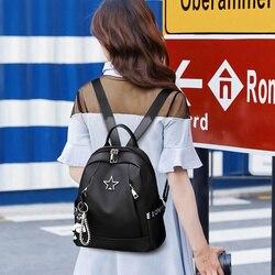 Nouveau femmes Oxford sac à dos étanche couleur noire sac d'école grande capacité sac de voyage décontracté avec pendentif