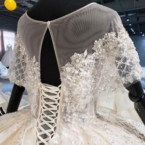 Image 5 - HTL1056 sparkly hochzeit kleid 2020 illusion oansatz perle kleine cape spitze hochzeit kleid plus größe lace up zurück vestido de casamento