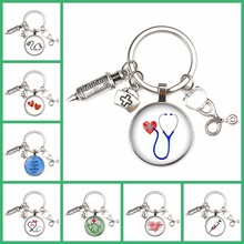 NEW Fashion Personalized Nurse Medical Syringe Stethoscope Image Keychain Glass Cabochon and Glass Dome Key Ring Pendant Gift(China)