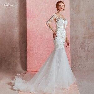 Image 5 - RSW1581 Sexy Sheer O neck z długim rękawem suknia ślubna o kroju syreny 2019 zobacz przez Illusion suknia ślubna wiązana z tyłu z koronki aplikacja