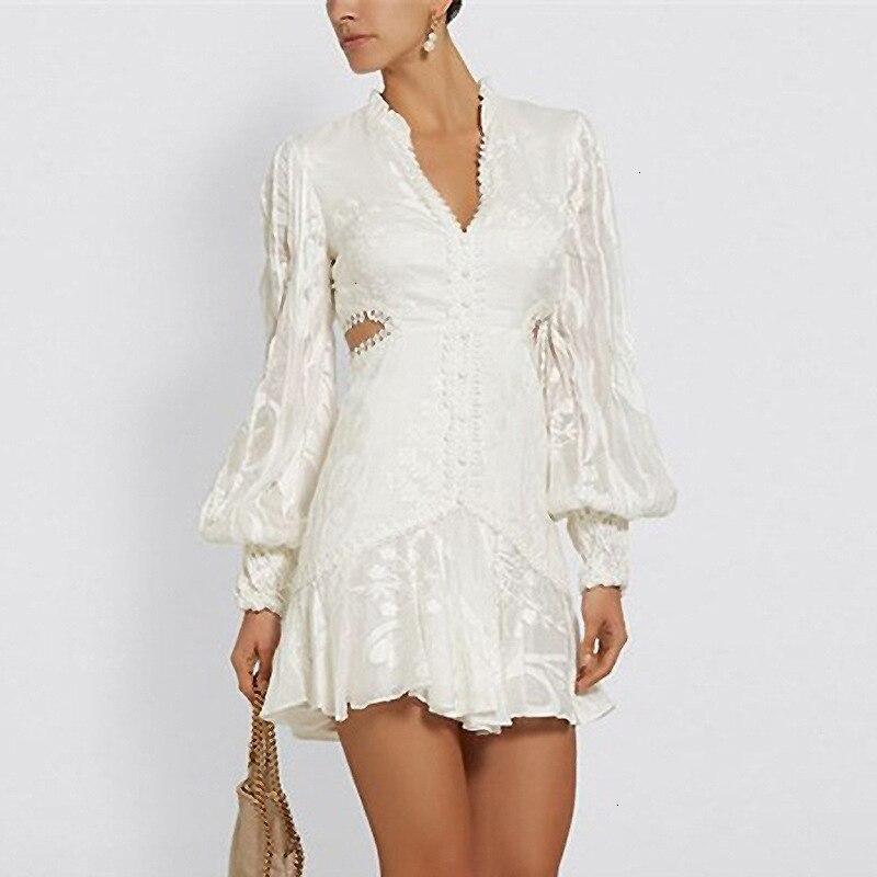 Nouveau magasin signe sexy rosée taille col en v lanterne manches de nouveau fonds d'hivers lourd broderie robe blanche femme