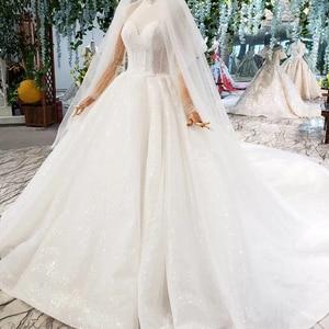 Image 3 - HTL823 فساتين زفاف لامعة مع الحجاب الزفاف الوهم o الرقبة فساتين زفاف طويلة مع الأكمام vestido de noiva 2020