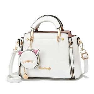 2020 new cat shape small wallet pendant metal handle solid color handbag large capacity women crossbody bag