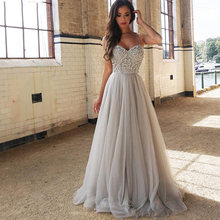 Серебристое длинное платье для выпускного вечера с кристаллами