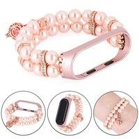Bracciale donna perline per Xiaomi Mi Band 6 5 4 3 cinturino orologio cinturino in finta perla per cinturino MIband rosa/bianco con cornice in metallo