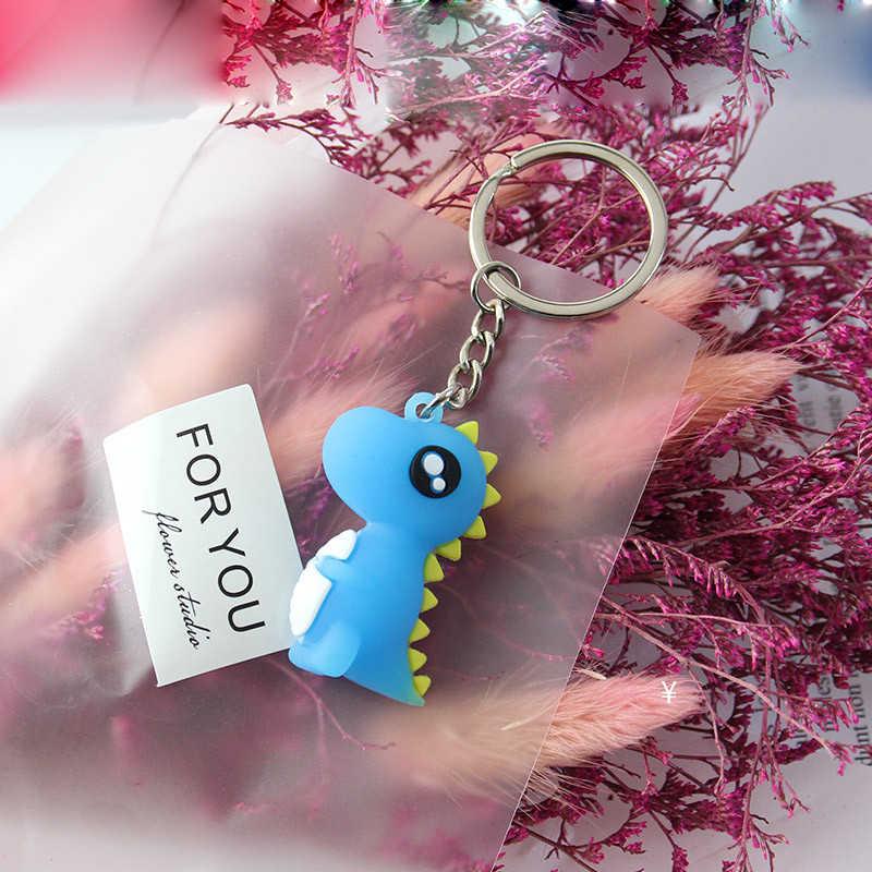 Gran oferta bonito llavero de dibujos animados pequeño dinosaurio llavero Animal PVC llaveros bolsa de mujer encanto llavero colgante regalos de alta calidad