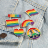 LGBT pins to clothes and gadgets