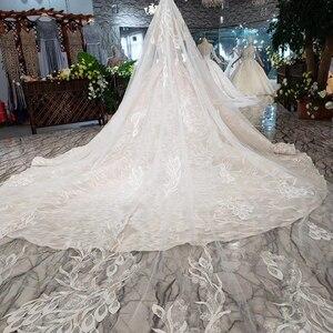 Image 2 - Bgw HT5620 suknie slubne 高級セクシーなストラップレスのウェディングドレスレースシャンパンアップリケ夜会服のウェディングドレス結婚式のベール