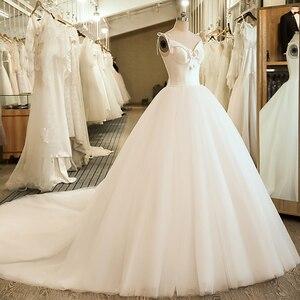 Image 3 - SL 5058 Cheap Sample Bow Wedding Bridal Dress Corset Ball Gown Satin Wedding Dress