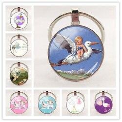 2020 nova moda artesanal chaveiro cegonha e bebê pingente chaveiro cúpula de vidro chaveiro feminino jóias presente
