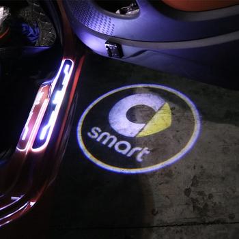 Drzwi samochodu lampa projektora laserowego dekoracji witamy modyfikacji światła dla smart 453 451 450 fortwo forfour akcesoria samochodowe do stylizacji tanie i dobre opinie TOONIES Wewnętrzny Zmiana koloru Z tworzywa sztucznego Klej naklejki Nie pakowane 6 5cm Karoserii YT-630 6 3cm