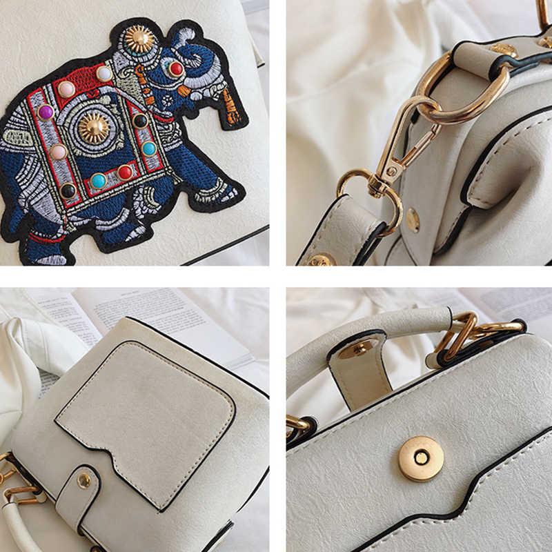 elephant embroidered leather shoulder bagclutch