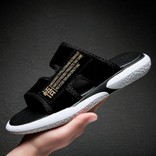 A word drag male tide 2020 summer new wear sandals and slippers youth trend Korean version of the personality soft bottom breath
