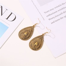 Ethnic Style Peacock Tail Retro Carved Personality Earrings Bohemian Metal Drop Pattern Earrings Aretes De Mujer Modernos цена