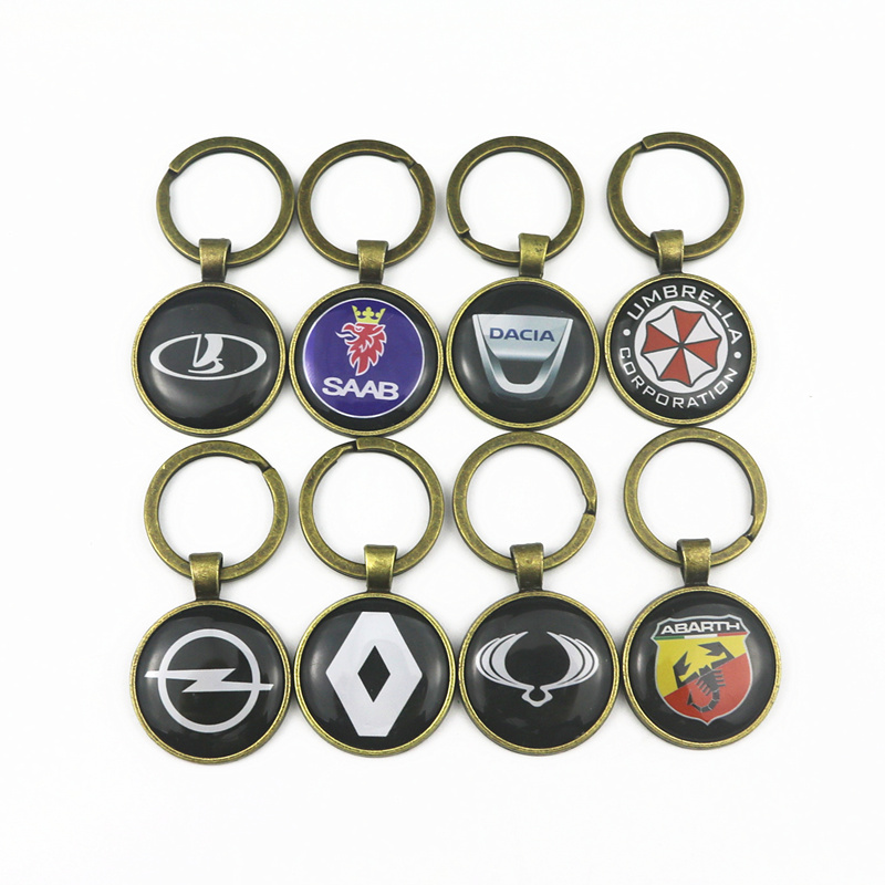 แฟชั่นบรอนซ์ใหม่สีโลหะพวงกุญแจรถสำหรับ Opel Opel Dacia Renault Saab Abarth Alfa Romeo สัญลักษณ์พวงกุญแจโซ่