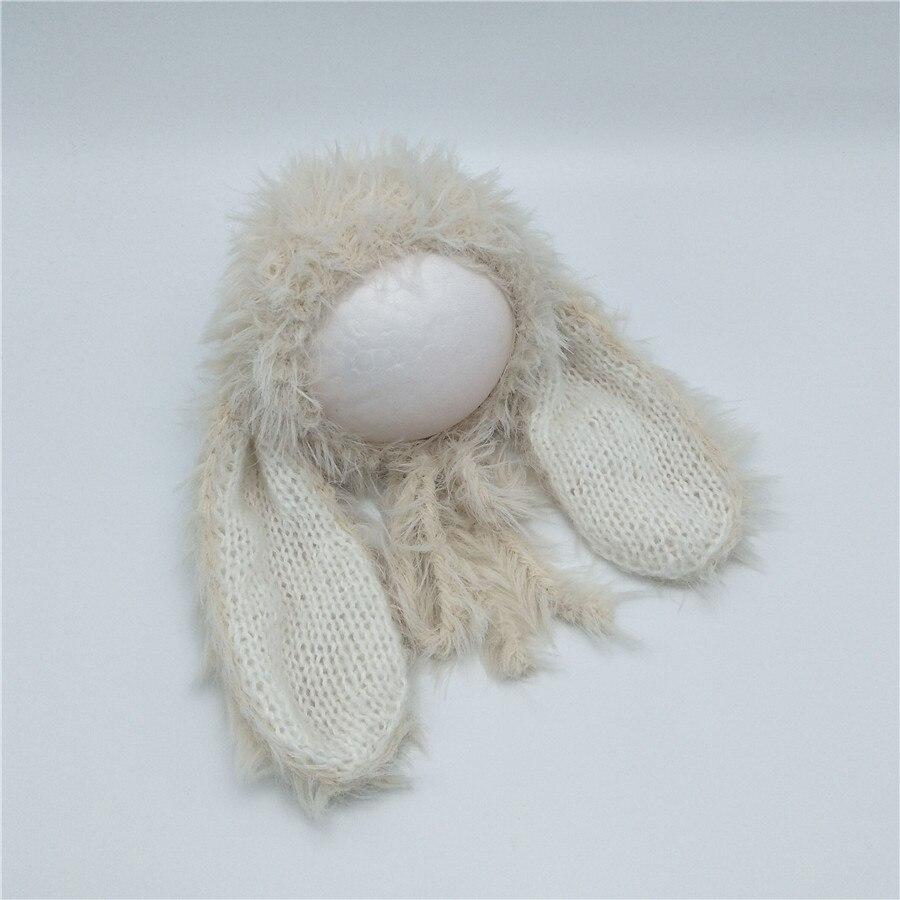 Muito adorável bebê recém-nascido longo peludo coelho