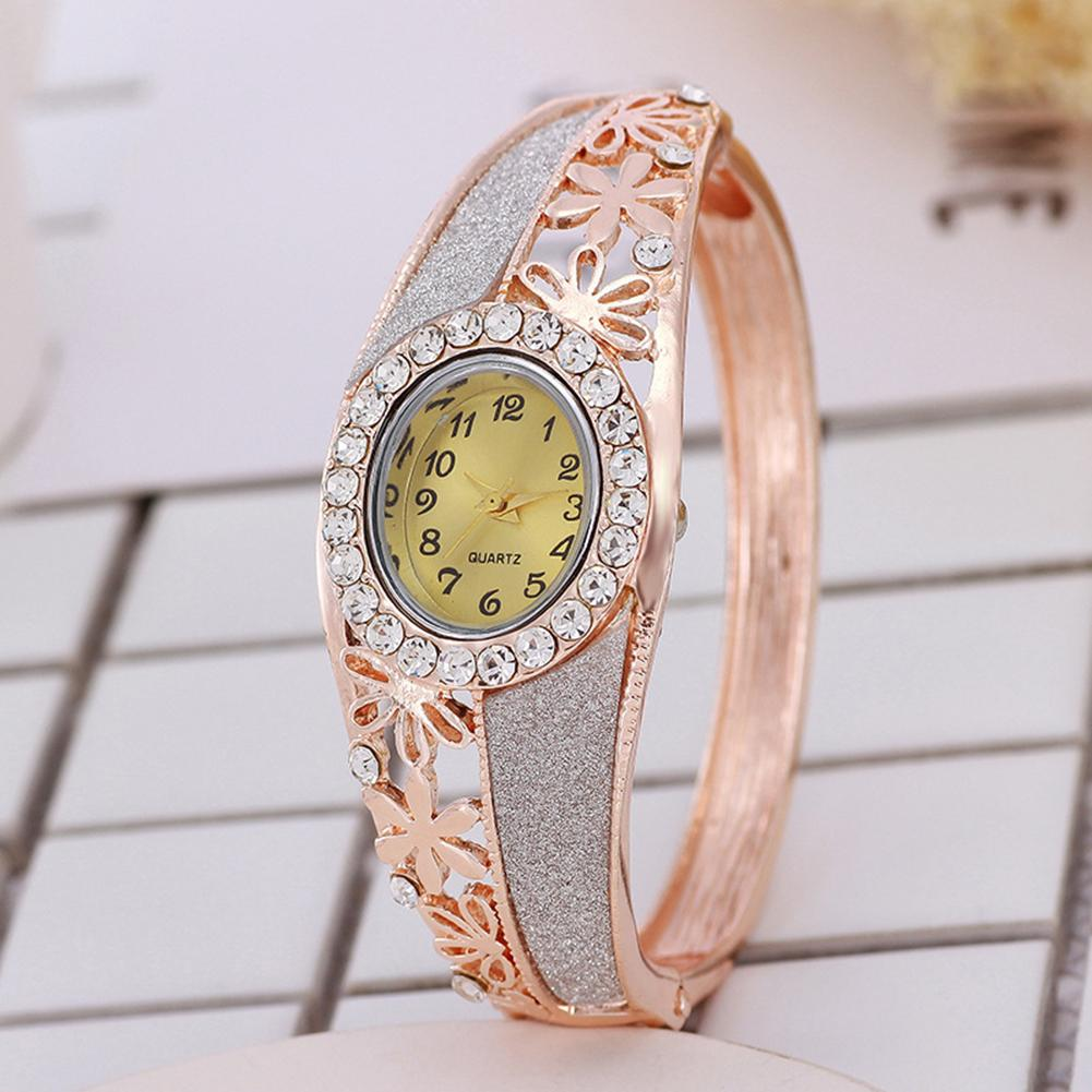 Top Luxury Women Bangle Watch Rhinestone Hollow Flower Band Fold-over Clasp Oval Dial Analog Quartz Wrist Watch Reloj De Mujer