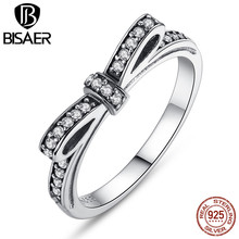 цена Authentic 100% 925 Sterling Silver Sparkling Bow Knot Stackable Ring Micro Pave CZ Wedding Jewelry P7104 онлайн в 2017 году