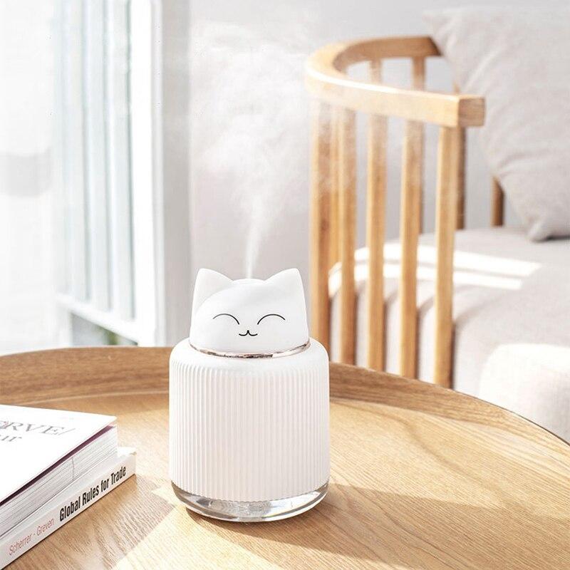 Ev Aletleri'ten Nemlendiriciler'de Mini hava difüzörü kesim Pet nemlendirici taşınabilir aromalı uçucu yağ difüzör 300ML araba hava spreyi sisleyici sıcak gece ışıkları title=