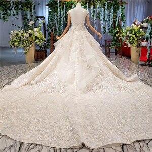 Image 2 - Champagne sans manches robes de mariée Sexy 2020 Dubai luxe paillettes plumes robes de mariée HX0005 sur mesure