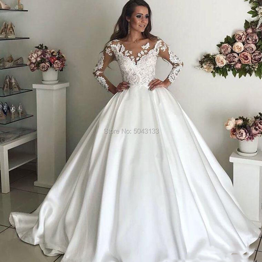 Elegant Satin Long Sleeves Wedding Dresses 2020 Sexy Sheer Scoop Neckline Lace Appliques Court Train Bridal Gowns Buttons Back