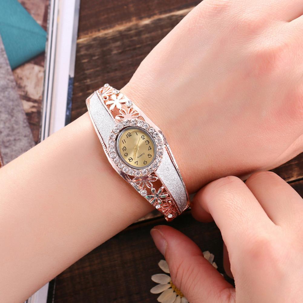 Luxury Women Rhinestone Hollow Flower Band Oval Dial Analog Quartz Bangle Watch Reloj De Mujer Fold-over Clasp Hollow Flower Ban