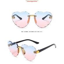 Bambino carino cuore montatura senza montatura occhiali da sole bambini bambini grigio rosa rosso lente moda ragazzi ragazze occhiali di protezione UV400